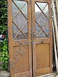 A pair of tall oak doors with astragal glazed