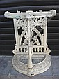 A cast iron demi lune umbrella stand.