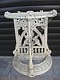 A cast iron demi lune umbrella stand.