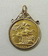 A George V gold sovereign, 1912, mounted, 9.4g.