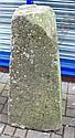 A saddle stone, lacking cap