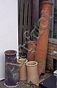 A Georgian Long Tom chimney pot, two other chimney