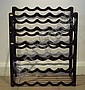 A wrought iron wine rack, approximately two feet
