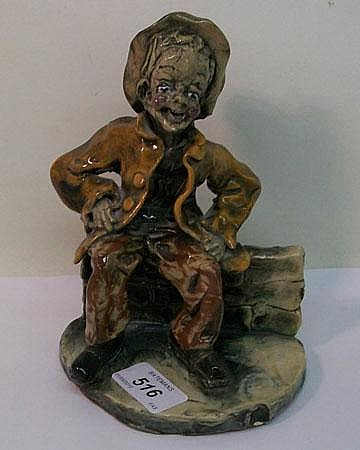 Norman Underhill figure of a laughing tramp,