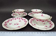 Three porcelain mocha cups with four saucers, by Herend, Hungary