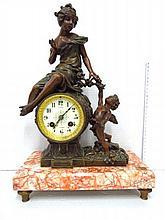 Mantel clock, by Petit Gambrai,