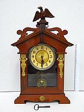 Mantelpiece clock, pendulum mechanism,
