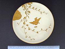 Porcelain plate, with an original Paul Blot hand painted bird image,