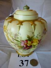 A Royal Worcester lidded vase decorated with gilt and flowers est: £50-£80 (M)