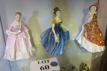 Three Royal Doulton figurines: The Paisley Shawl HN 1392 (a/f); Melanie HN 2271; a Hostess of Williamsburg HN 2209 (3) est: £30-£50 (O1)