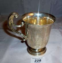 A heavy silver Christening mug with double scroll handle London 1906 est: £100-£150