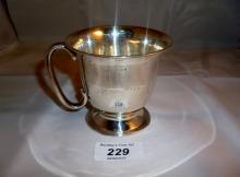 A silver Christening mug with 'C' shaped handle Birmingham 1926 est: £60-£80