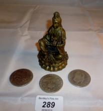 A metal Indian god figure and three coins est: £15-£25