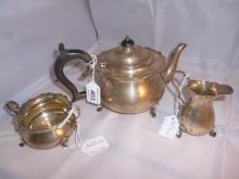 A three piece silver tea service comprising teapot, cream jug and sugar bowl London 1916 est: £220-£280