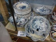 A Staffordshire 'Delph' pattern blue and white part dinner service to include tureens and stands approx 35 pieces some a/f est: £50-£80 (H)