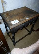 A c1900 oak carved side table with turned legs and stretcher est: £15-£30