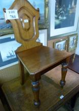 A 19c mahogany shield shape hall chair of good colour est: £40-£60