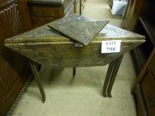An early 20c oak carved corner table with a drop leaf est: £30-£50