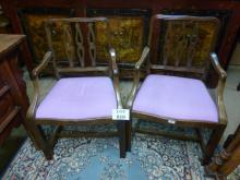 A pair of early 20c carver armchairs upholstered in purple est: £80-£120