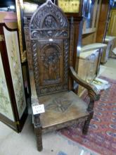 A Victorian oak Gothic high back throne chair with carved faces & monk to back c1850-70 est: £400-£600