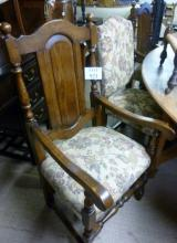 A set of six oak framed dining chairs to include two carvers est: £200-£300