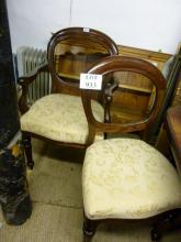 A set of eight Victorian style mahogany balloon back chairs upholstered in cream est: £140-£220