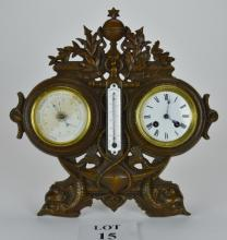 A late 19th/early 20th century French nautical theme combination clock, barometer and thermometer mounted in a decorative 'bronzed' stand est: £100-£150 (G1)