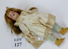 A German JD Kestner mould 249 bisque head girl doll  with brown glass sleeper eyes, open mouth with upper teeth, blonde wig, on a fully jointed composite body, incised 'JDK 249 Made In Germany', 45 cm tall approx est: £100-£200 (B6)