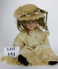 A Continental bisque head doll with sleeping blue glass eyes, open mouth showing upper teeth, blonde wig, jointed composite body, incised '5' to head, 53 cm tall approx, together with some additional clothes and shoes est: £50-£80 (B28)