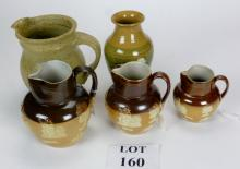 A graduated set of three Doulton harvest ware jugs; another stoneware jug and a Boscastle pottery vase est: £40-£60 (B15)