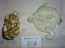 A Chinese carved jade Buddha pendant and a jade dragon carved pendant (a/f) est: £30-£50