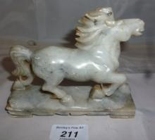 A Chinese soapstone carving of a horse est: £35-£45