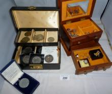 Two jewellery boxes, a pipe and one containing various coins and other items of jewellery to include two Mickey Mouse brooches and various rings est: £20-£40
