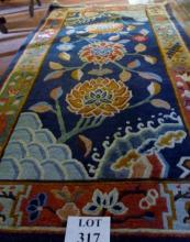 A thick piled chisel design rug depicting flowers on a blue ground est: £50-£80