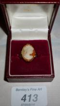 A 10ct gold cameo ring (size G) boxed est: £80-£120