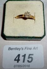 An 18ct gold solitaire diamond ring (size L) est: £400-£600