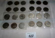A collection of twenty four various Chinese coins est: £30-£50