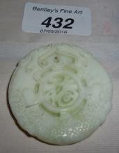 A Chinese white jade pendant of dragons est: £30-£40