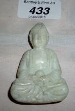 A Chinese white jade Buddha pendant est: £30-£40