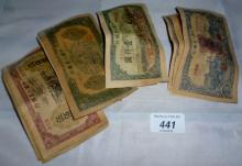 A Collection of 15 Chinese paper money est: £50-£60