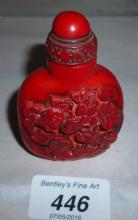 A Chinese red lacquered snuff bottle decorated with fish est: £30-£40