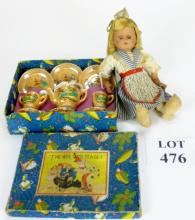 A Doll's Wee Tots Tea set, boxed and a Dutch character doll (a/f) est: £15-£25 (F14)