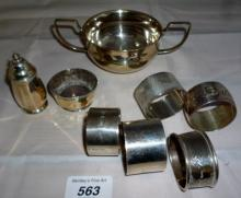 A collection of 4 silver napkin rings fully hallmarked, a silver pepper pot, a silver salt and a plated bowl and napkin ring est: £40-£60