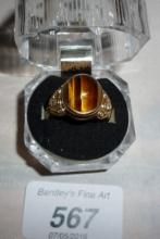 A 18ct rose gold tiger's eye poison ring (size S) boxed est: £300-£400