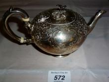 A small Victorian silver teapot embossed with flowers London 1864 est: £90-£120