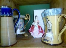 A Royal Doulton figurine Southern Belle pink (boxed) together with a Doulton Lambeth jug with silver collar; a Doulton 'Old Bob Ye Guard' jug and a decorative Continental tyg (all a/f) est: £30-£50 (F7)