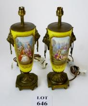 A decorative pair of porcelain and gilt metal mounted lamp bases painted with figural panels one signed 'Morin' on a yellow and gilt ground in the Sevres style,  34 cm high approx shades in office) est: £100-£150 (J)