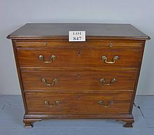 A George II mahogany Bachelor's chest with brushing slide over three drawers and ogee bracket feet c1760 est: £200-£400