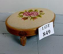 A small oval foot stool with needlework top est: £20-£25