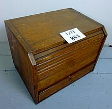 An early 20c oak tambour fronted table top cabinet est: £20-£30